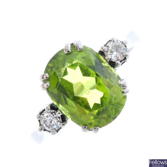 A peridot and diamond ring.