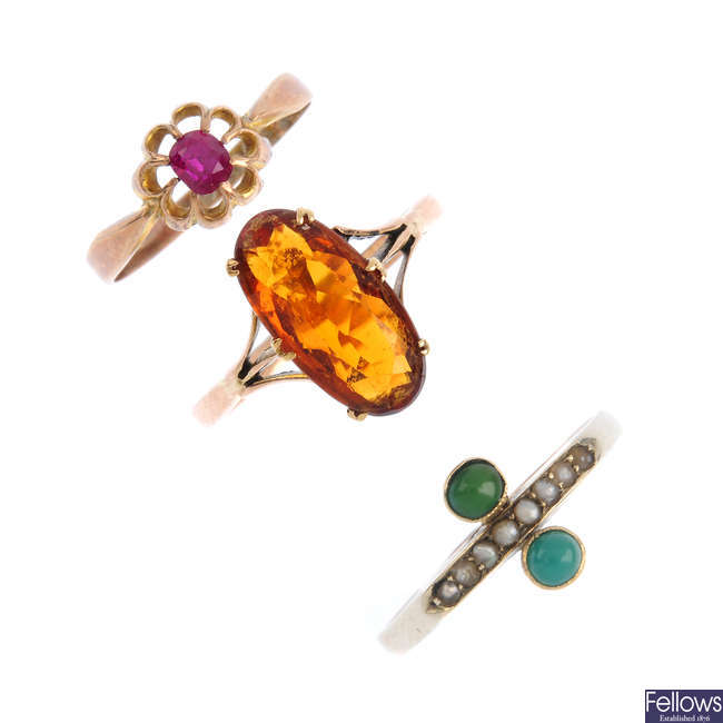 Three rings, a pendant and a stickpin.
