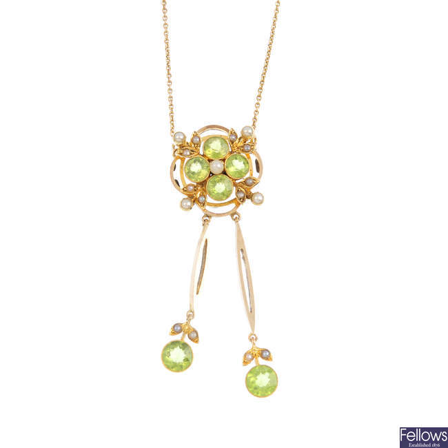 An early 20th century gold peridot and split pearl pendant, on chain.