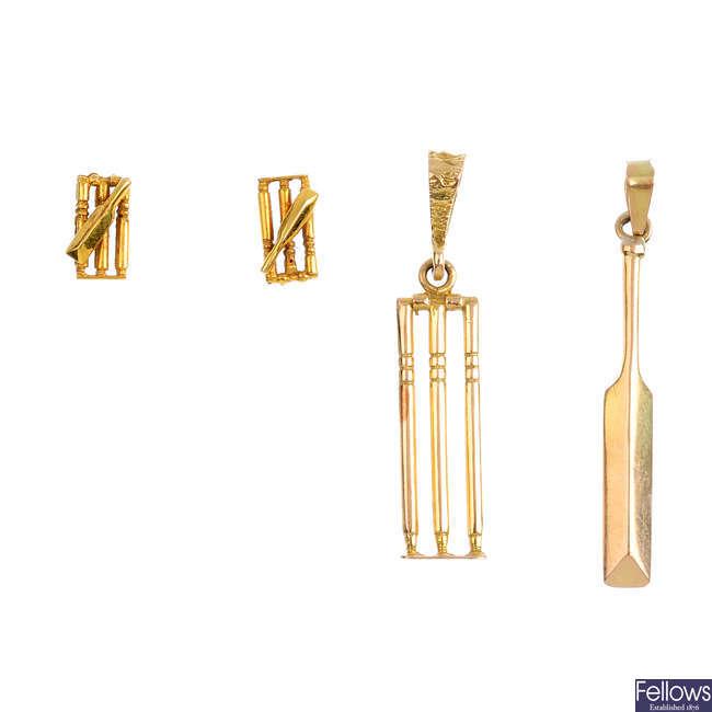 Three items of cricket jewellery.