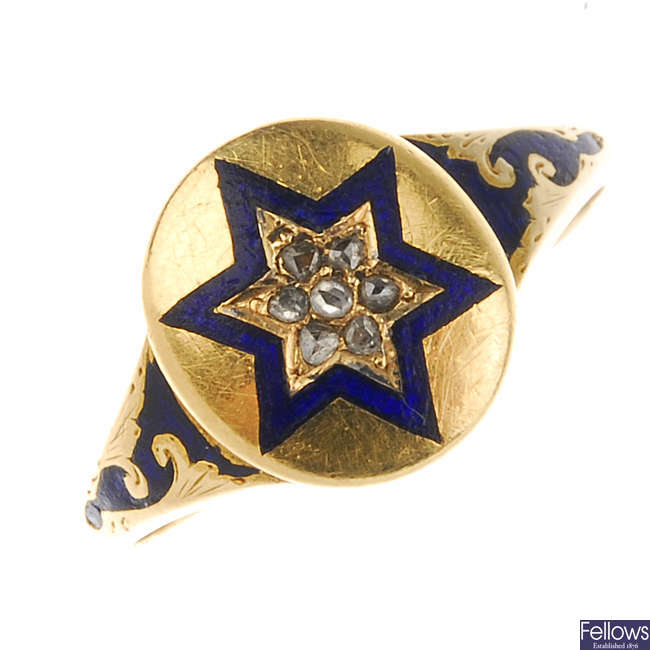 A mid Victorian gold diamond and enamel memorial ring.