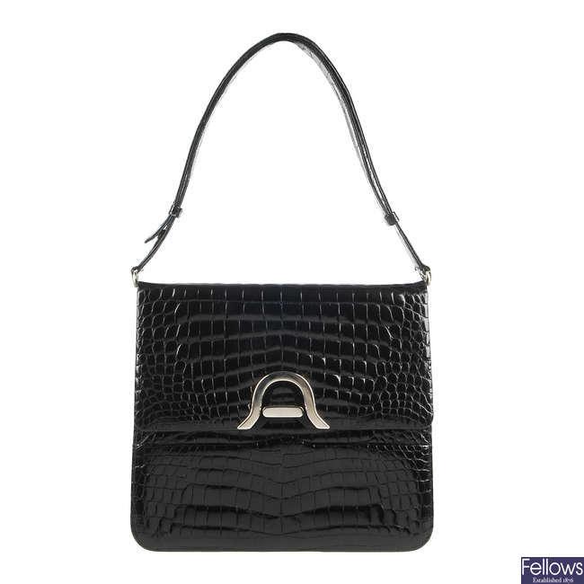 ALFRED ROTH - a vintage crocodile handbag.