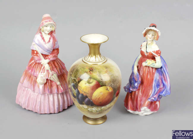 Two Royal Doulton figurines, together with two Royal Worcester bone china vases.