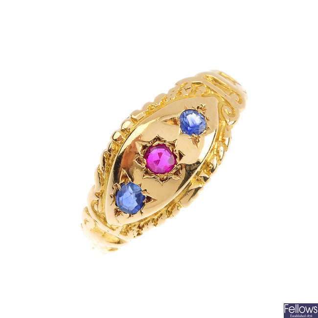 A synthetic ruby and sapphire three-stone ring.