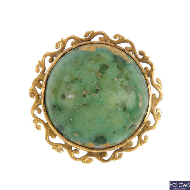 A reconstituted turquoise brooch.