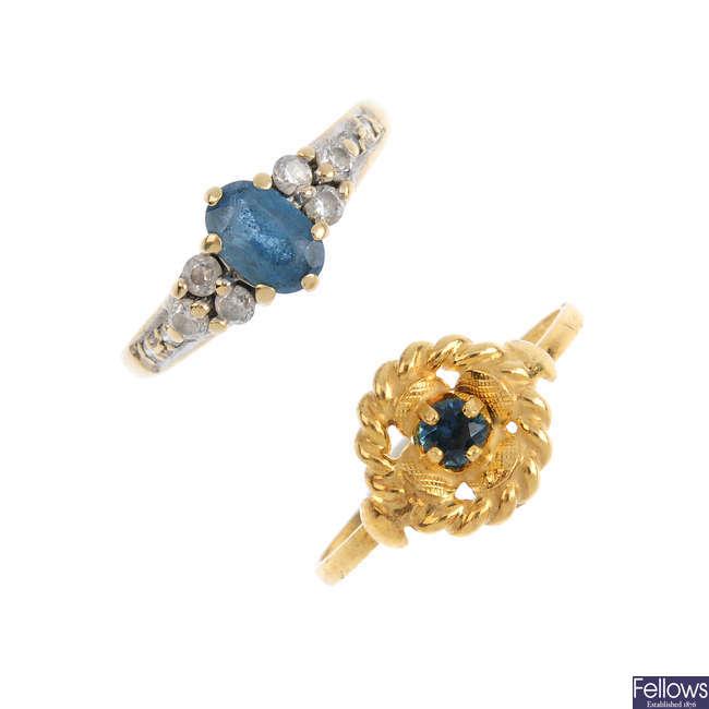 Five gold gem-set rings.