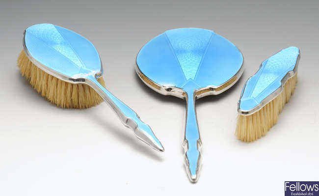 A 1930's three piece silver mounted and enamel dressing table set.