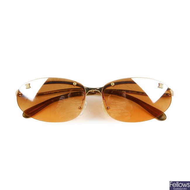 CÉLINE - a pair of rimless sunglasses.