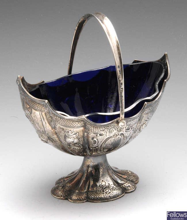 A Victorian silver pedestal sugar basket.