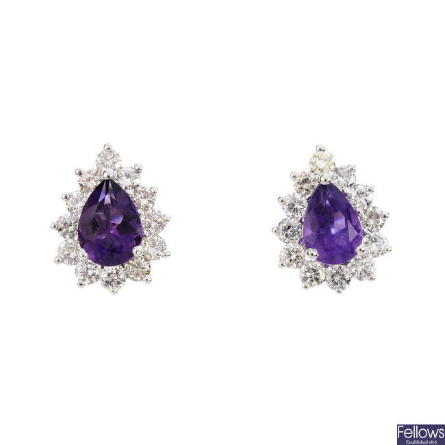 A pair of amethyst and diamond cluster earrings.