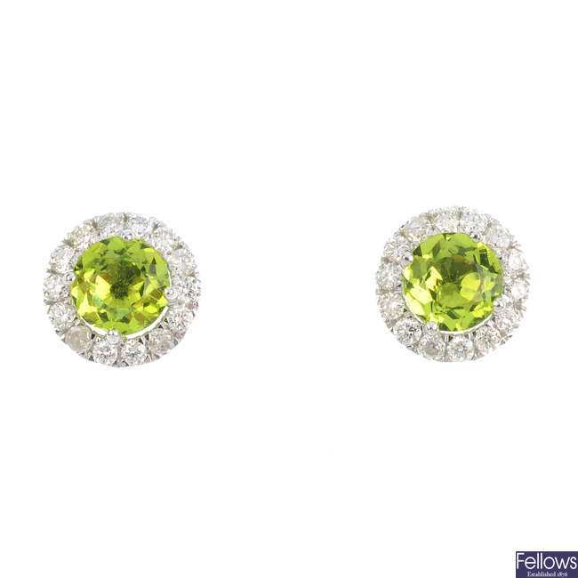 A pair of peridot and diamond cluster earrings.