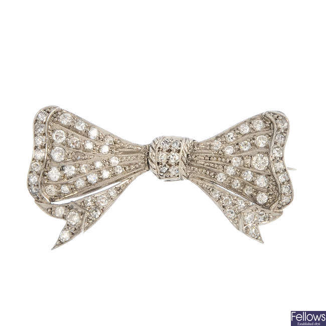 A mid 20th century diamond bow brooch.