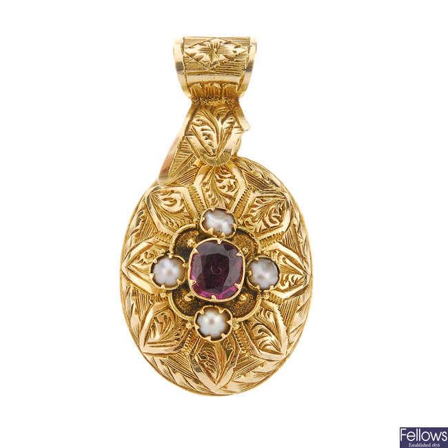 A late Victorian garnet and split pearl memorial pendant.