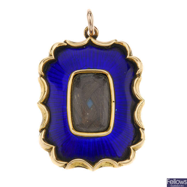 A late Victorian gold and enamel memorial pendant.