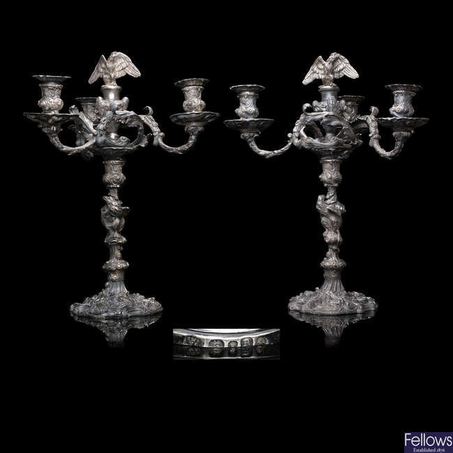 An impressive pair of Regency silver four-light candelabra.