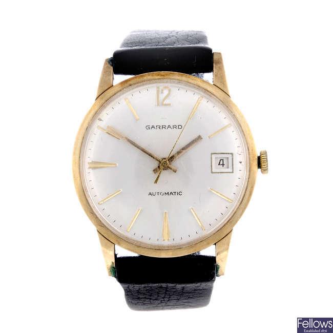 GARRARD - a gentleman's 9ct yellow gold wrist watch with an Omega watch head.