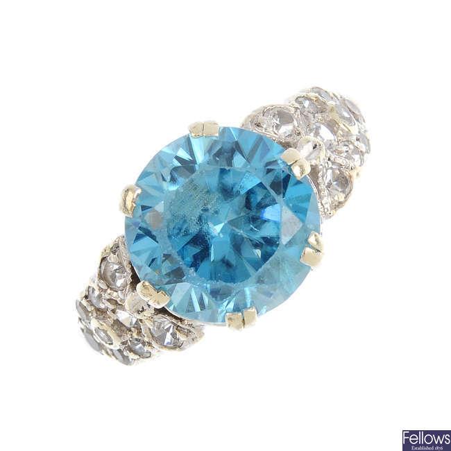 A zircon and gem-set dress ring.