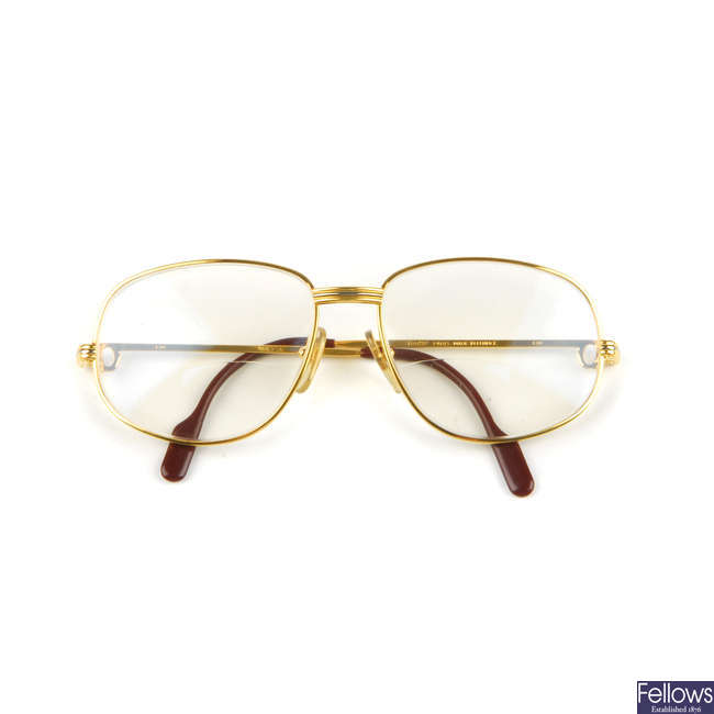 CARTIER - a pair of gold-plated prescription glasses.