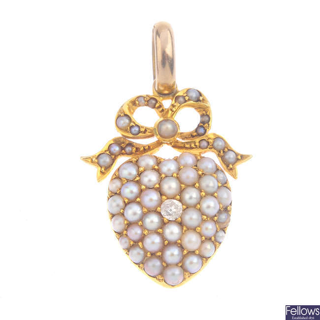 A late Victorian diamond and split pearl pendant.