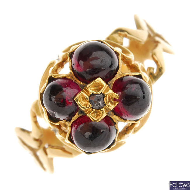 An early 19th century gold garnet and diamond ring.