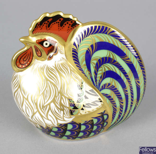 A Royal Crown Derby porcelain paperweight modelled as a farmyard cockerel.