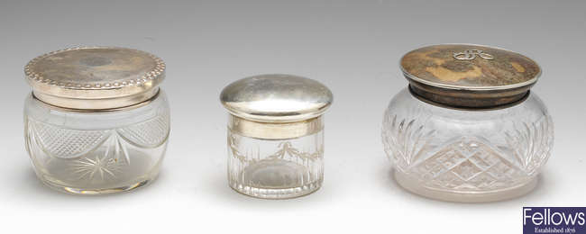 Three 1920's silver lidded pots and a plated enamelled example. (4).