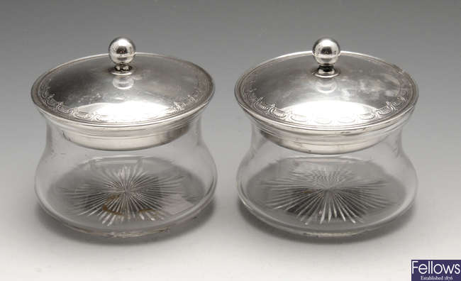 A pair of 1920's silver lidded powder pots.