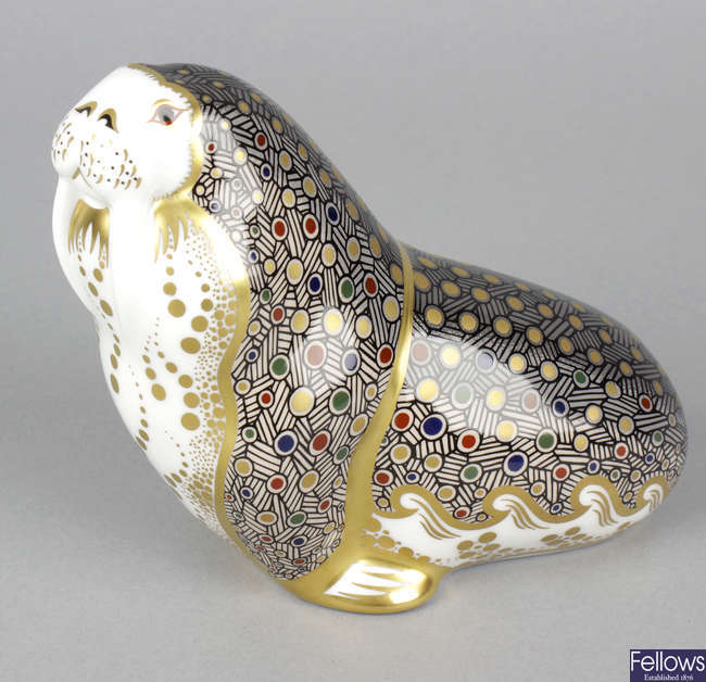 A Royal Crown Derby porcelain paperweight modelled as a walrus.
