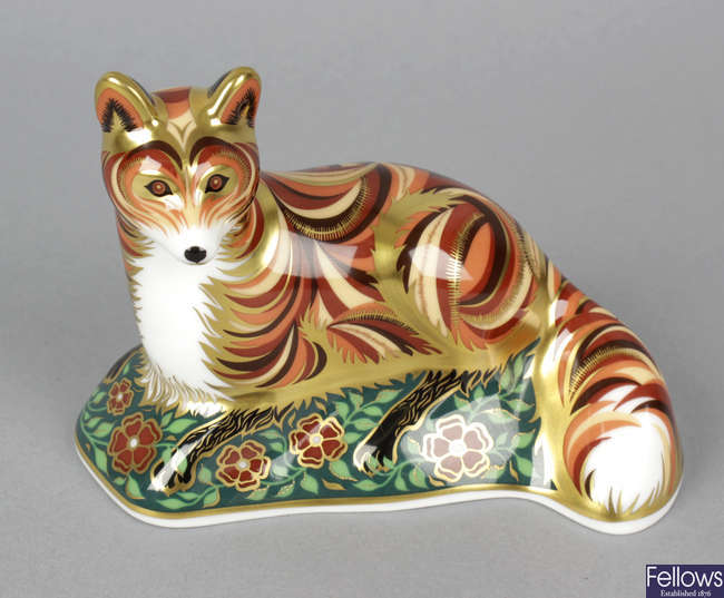 A Royal Crown Derby porcelain paperweight.
