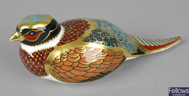 A Royal Crown Derby porcelain paperweight modelled as a woodland pheasant.