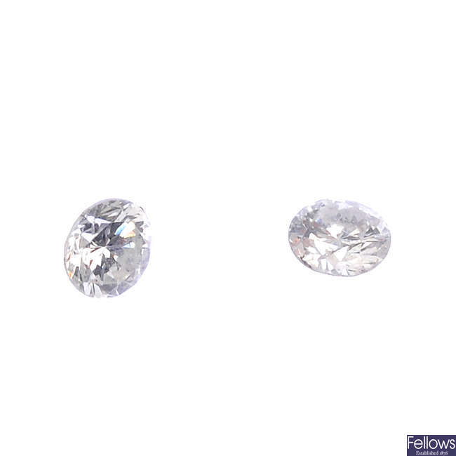 Two brilliant-cut diamonds.