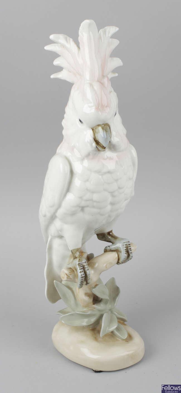 A Royal Dux porcelain figurine modelled as a cockatoo.