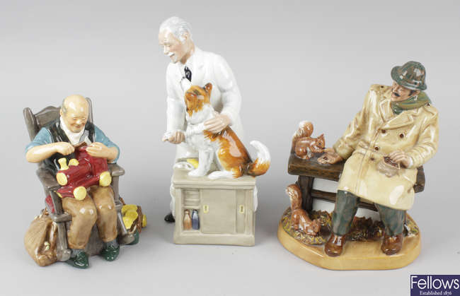 A group of three Royal Doulton figurines.