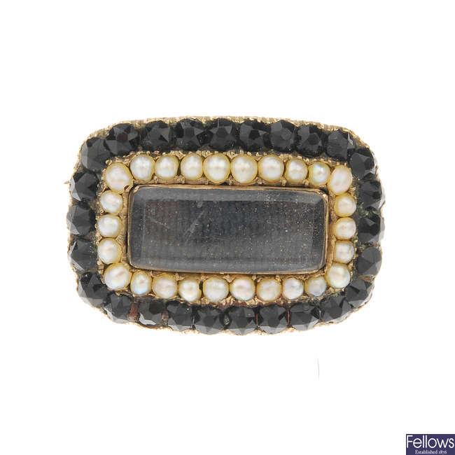 A mid Victorian gold garnet and split pearl memorial brooch.