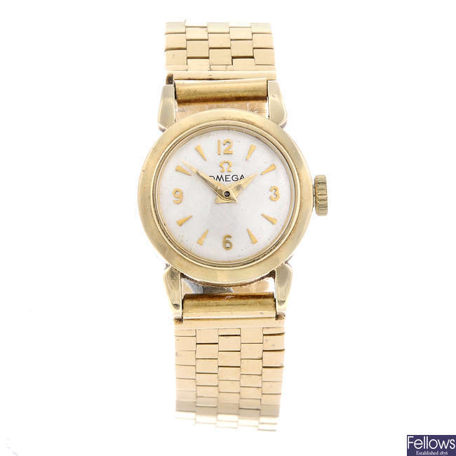 OMEGA - a lady's yellow metal bracelet watch.