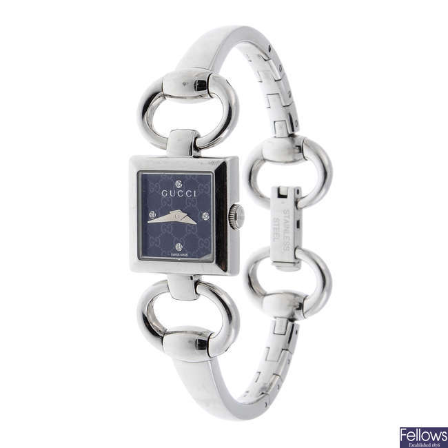 GUCCI - a lady's stainless steel bracelet watch.