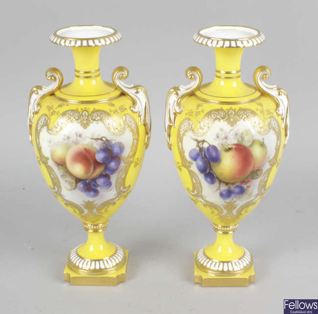 A pair of Royal Worcester bone china vases.