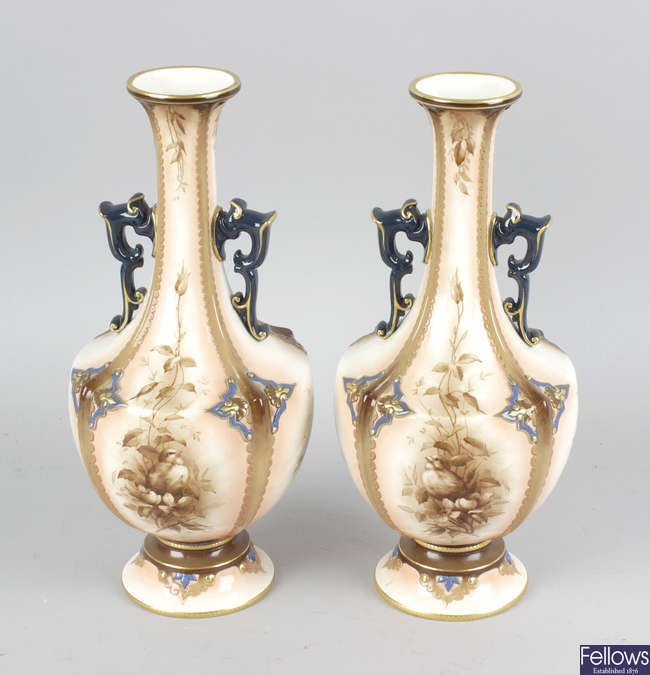 A pair of Hadley's Worcester faience vases.
