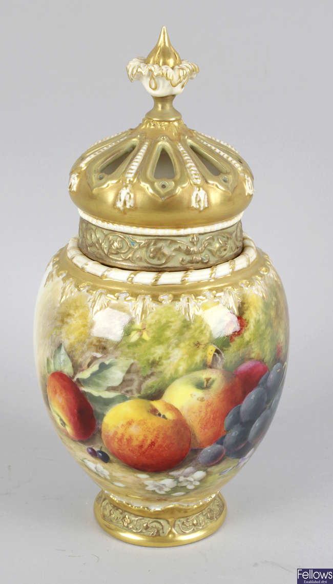A Royal Worcester bone china potpourri vase and cover.
