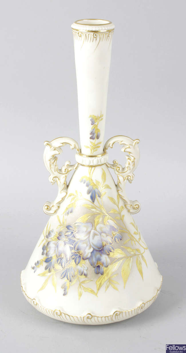 A Royal Worcester bone china twin handled conical shaped vase.