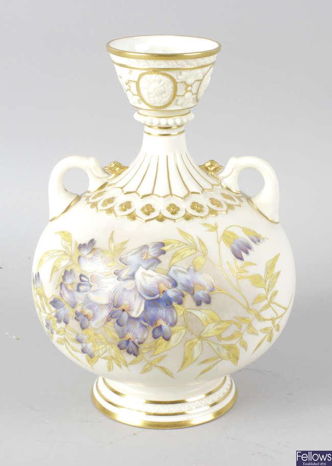 A Royal Worcester bone china twin handled globular shaped vase.