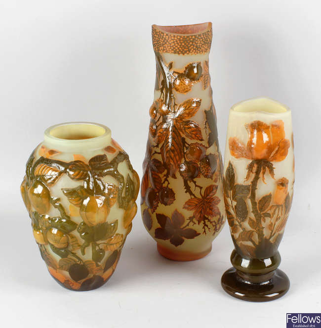 A reproduction Galle cameo style glass vase decorated with roses, another similar example decorated with fruits, etc.