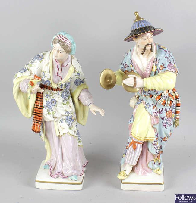 A pair of large German porcelain figurines.