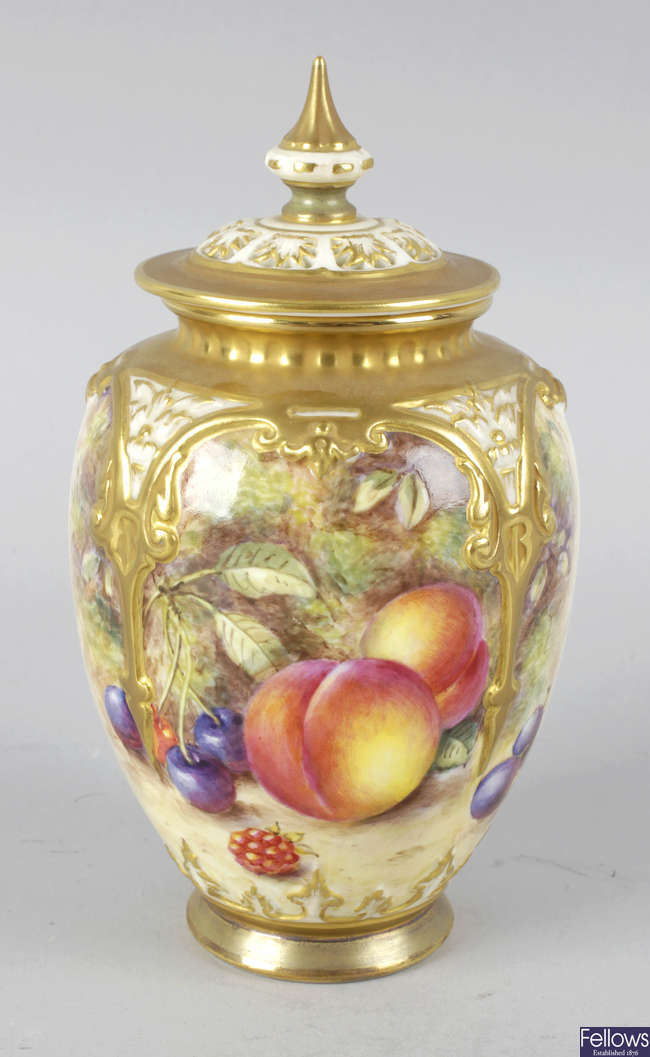 A Royal Worcester bone china vase with pierced cover.