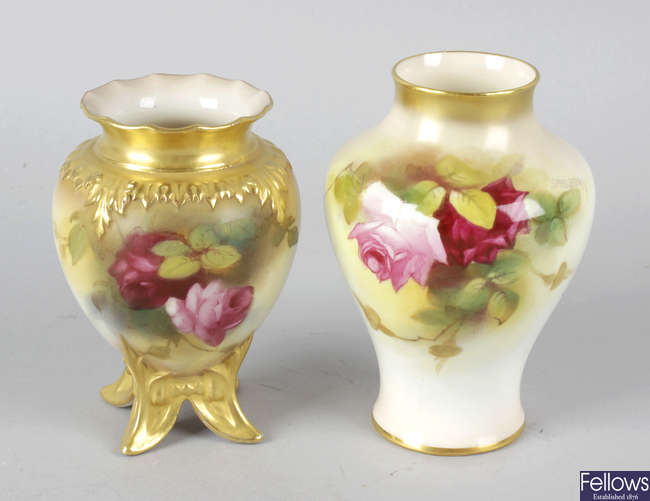 A Royal Worcester bone china vase hand painted with roses, together with another similar vase.