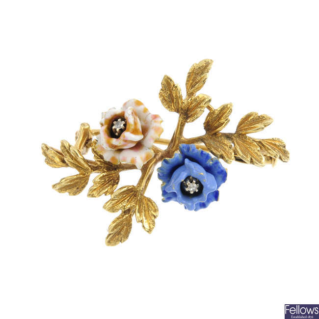 A diamond and enamel floral brooch.