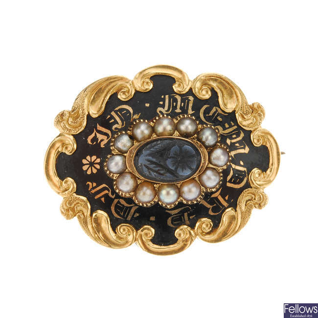 A late Victorian gold enamel, split pearl and onyx memorial brooch.