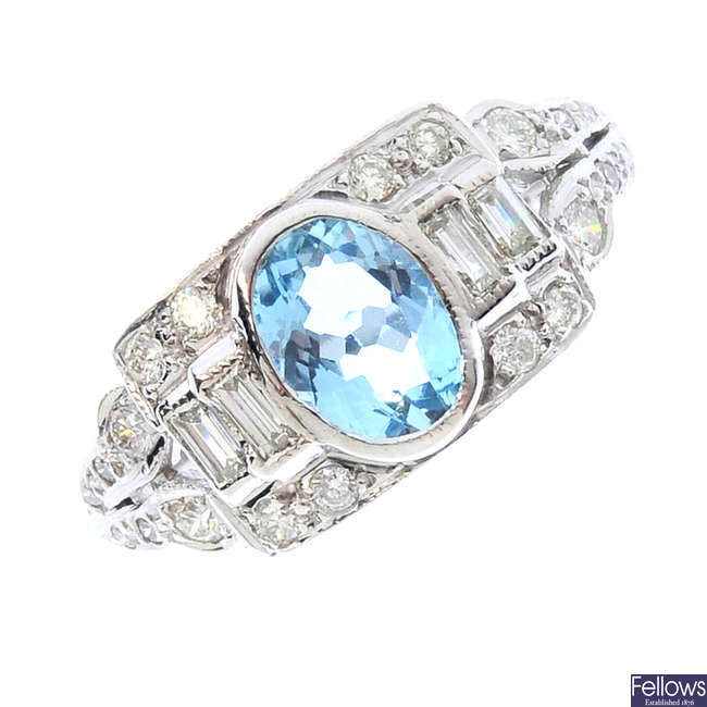 An aquamarine and diamond dress ring.