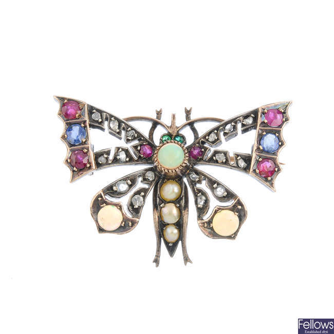 An early 20th century gold and silver gem-set butterfly brooch.