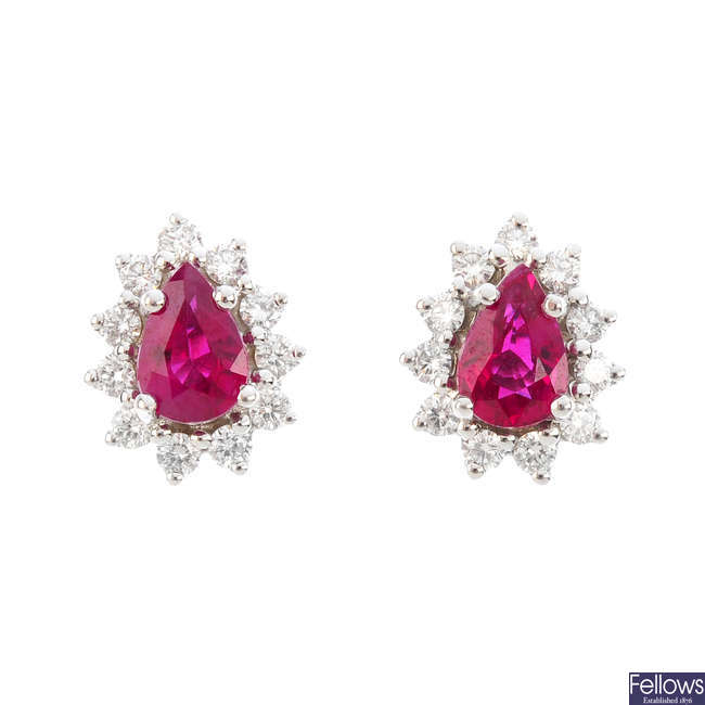 A pair of 18ct gold ruby and diamond cluster earrings.